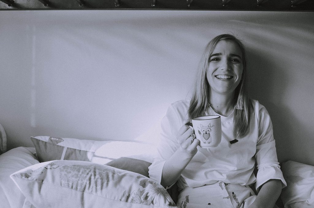 Black and white photo of girl with mug