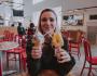 Girl holding two ice-cream cones.