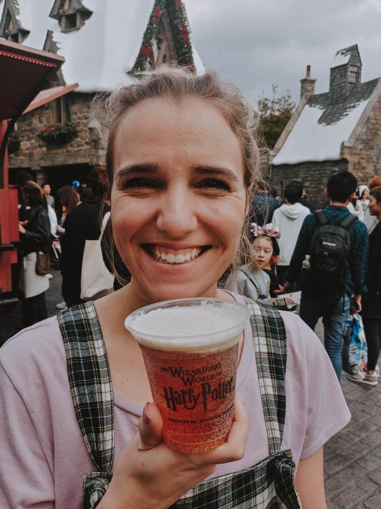 Girl holding butterbeer.