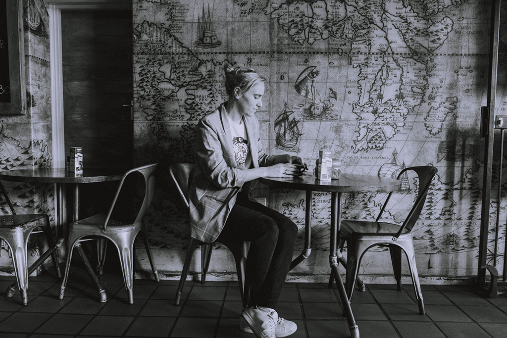 Girl sitting in coffee shop in Simonstad.