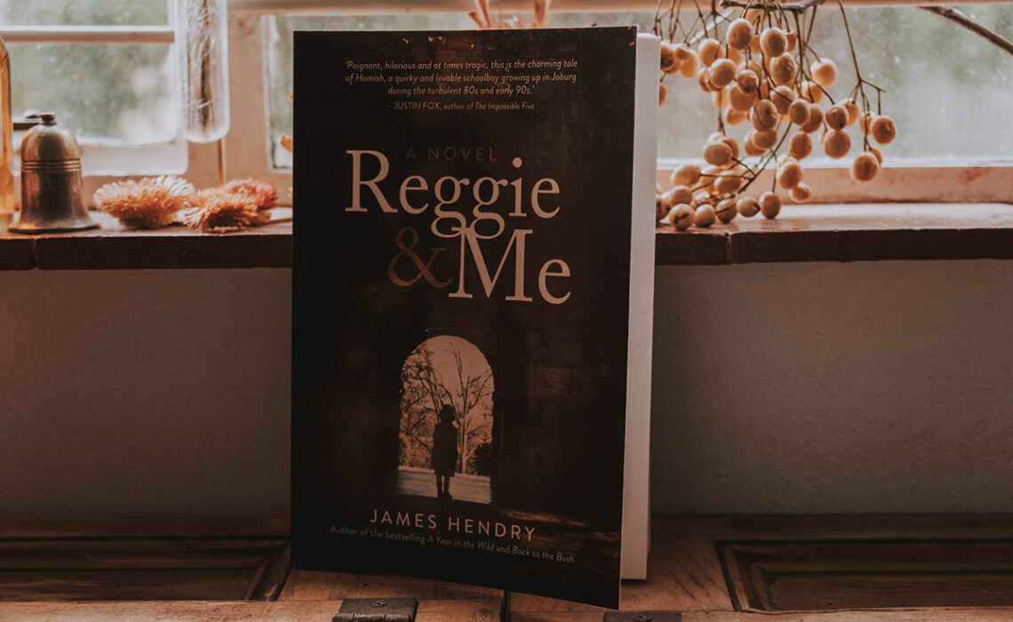 Front cover of Reggie and Me by James Hendry on kitchen counter.